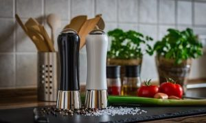 salt and pepper shakers sitting on a kitchen counter
